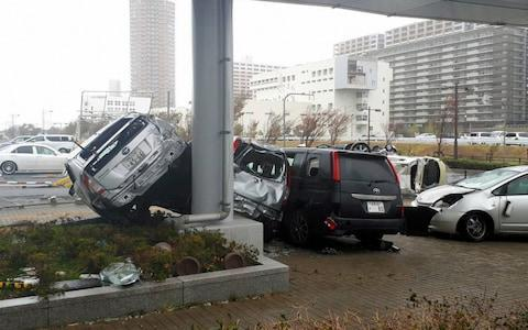 <span>Cars are blown off by strong wind triggered by Typhoon Jebi</span> <span>Credit: Getty </span>