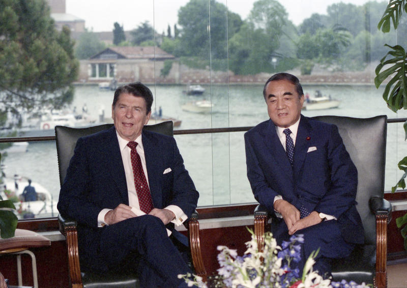 FILE - In this June 8, 1987 file photo, U.S. President Ronald Reagan, left, and Japanese Prime Minister Yasuhiro Nakasone attend their meeting at the Cipriani Hotel, in Venice. One of Japan's most prominent former leaders, Nakasone has turned 100 years of age, fitting in a country known for longevity Nakasone, born on May 27, 1918, turns 100 on Sunday, May 27.(AP Photo, File)
