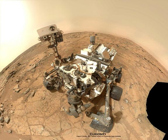 This self-portrait, composed of more than 50 images taken by Curiosity's MAHLI camera on Feb. 3, 2013, shows the rover at the John Klein drill site. A drill hole is visible at bottom left.