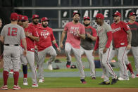 Washington Nationals third baseman Anthony Rendon, middle, warms up during batting practice for baseball's World Series Monday, Oct. 21, 2019, in Houston. The Houston Astros face the Washington Nationals in Game 1 on Tuesday. (AP Photo/David J. Phillip)