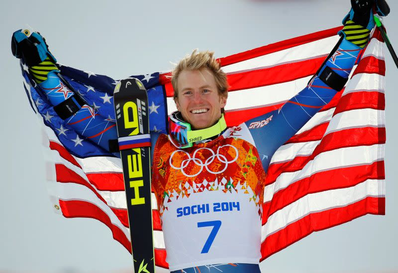 FILE PHOTO: Winner Ted Ligety of the U.S. holds up his national flag during the flower ceremony for the men's alpine skiing giant slalom event in the Sochi 2014 Winter Olympics at the Rosa Khutor Alpine Center