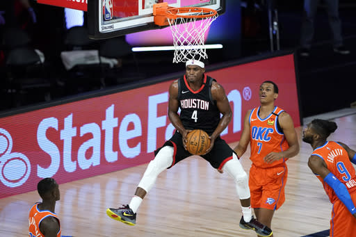 Houston Rockets' Danuel House Jr. (4) grabs a rebound in front of Oklahoma City Thunder's Darius Bazley (7) during the first half of an NBA basketball first round playoff game Saturday, Aug. 29, 2020, in Lake Buena Vista, Fla. (AP Photo/Ashley Landis)