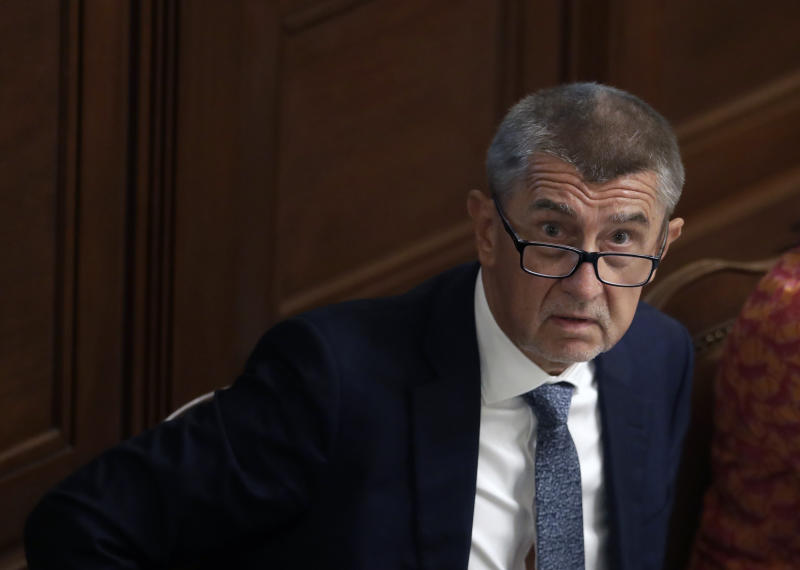 FILE - In this Wednesday, June 26, 2019, file photo, Czech Republic's Prime Minister Andrej Babis looks up during a parliament session in Prague, Czech Republic. On Wednesday, Dec. 4, 2019, the Czech Republic's prosecutor general has overturned a previous decision by the prosecution to drop charges against Czech Prime Minister Andrej Babis over alleged fraud involving European Union subsidies. (AP Photo/Petr David Josek, File)