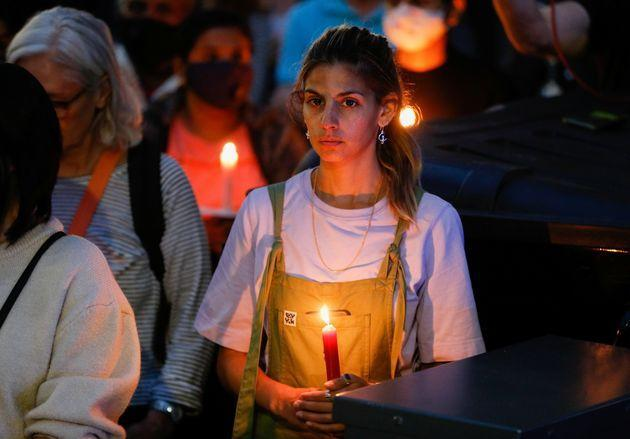 <strong>A person holds a candle during a vigil in memory of Sabina Nessa.</strong> (Photo: Peter Nicholls via Reuters)