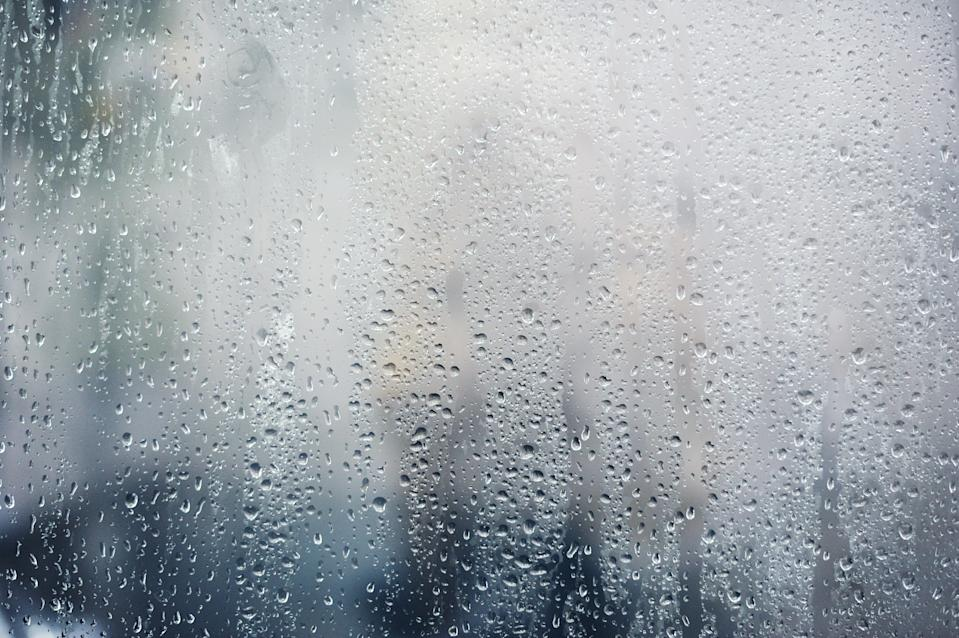 Rainy background, rain drops on the window, autumn season backdrop, abstract textured wallpaper.