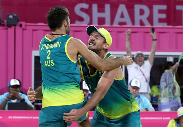 Beach Volleyball - Gold Coast 2018 Commonwealth Games - Men's Gold Medal Match - Australia v Canada - Coolangatta Beachfront - Gold Coast, Australia - April 12, 2018. Damien Schumann and Christopher McHugh of Australia celebrate winning a gold medal. REUTERS/Athit Perawongmetha