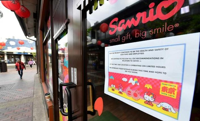 A sign posted on a Sanrio store in the Little Tokyo district of Los Angeles announces its temporary closure as the coronavirus pandemic brings much of the world to a standstill (AFP Photo/Frederic J. BROWN)