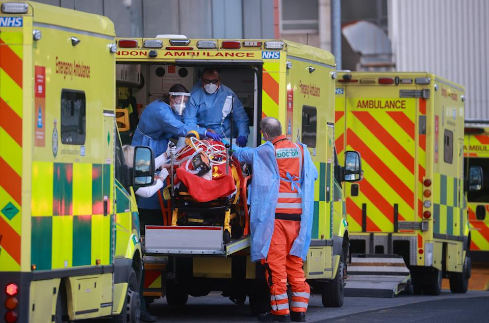 Medics transport a patient from an ambulance to the Royal London Hospital as the spread of the coronavirus disease (COVID-19) continues in London, Britain, January 2, 2021. REUTERS/Hannah McKay