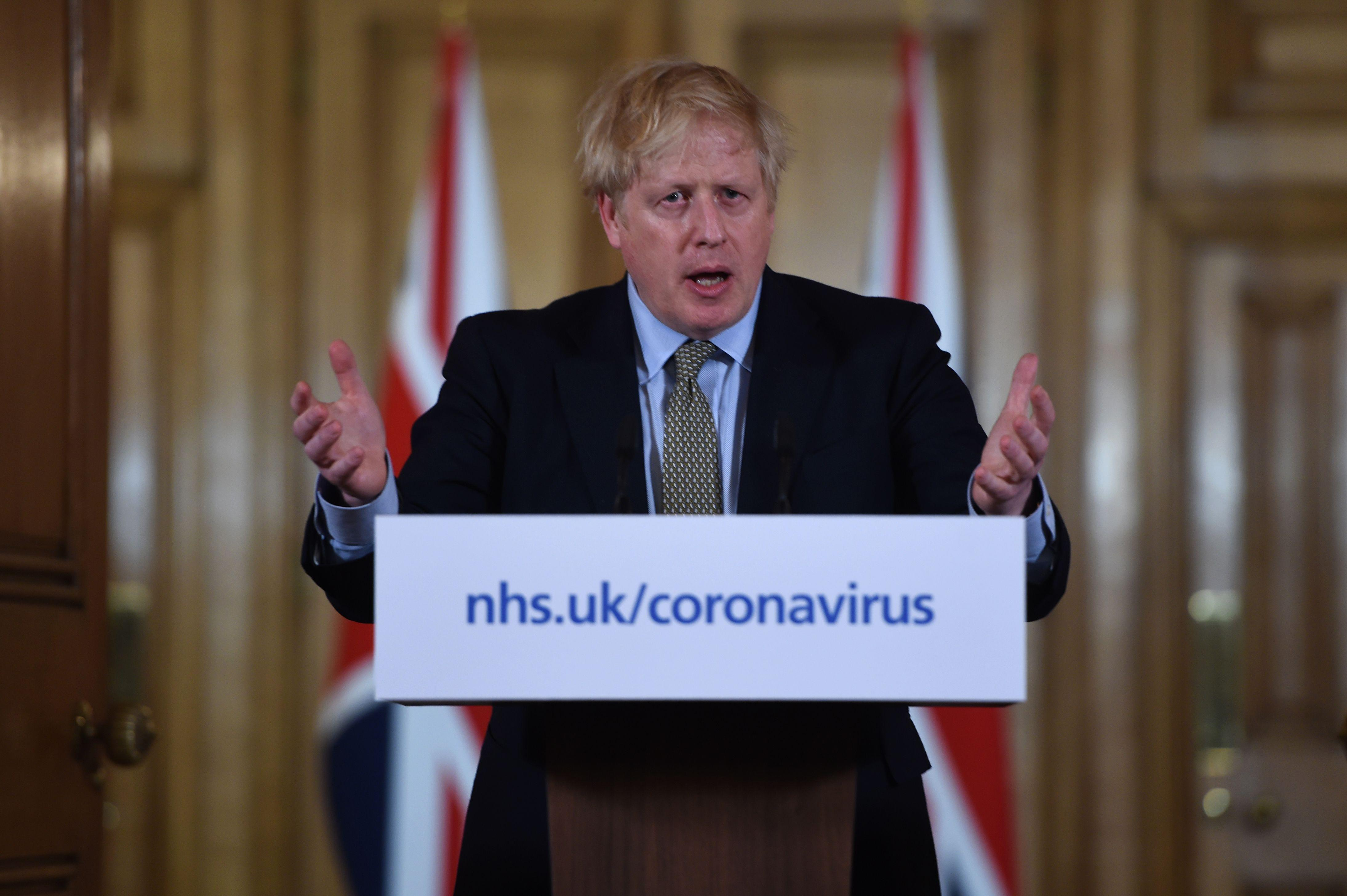 Britain's Prime Minister Boris Johnson addresses a news conference to give a daily update on the government's response to the novel coronavirus COVID-19 outbreak, inside 10 Downing Street in London on March 18, 2020. (Photo by Eddie MULHOLLAND / POOL / AFP) (Photo by EDDIE MULHOLLAND/POOL/AFP via Getty Images)