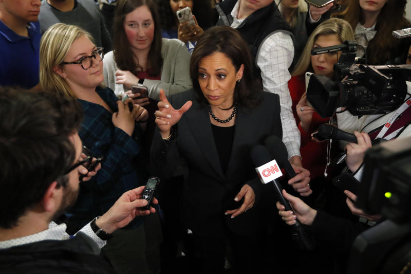 Sen. Kamala Harris, D-Calif., center, speaks to reporters at Drake University, Monday, Jan. 28, 2019, in Des Moines, Iowa. Harris formally announced on Sunday that she was seeking the Democratic presidential nomination. (AP Photo/Charlie Neibergall)
