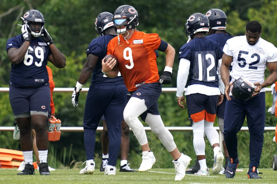 Chicago Bears quarterback Nick Foles (9) runs on the field during NFL football practice in Lake Forest, Ill., Wednesday, July 28, 2021. (AP Photo/Nam Y. Huh)