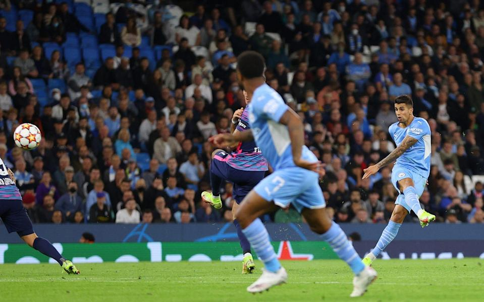 Joao Cancelo of Manchester City scores their side's fifth goal during the UEFA Champions League group A match between Manchester City and RB Leipzig - Richard Heathcote/Getty Images