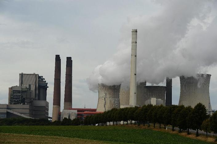 Countries need to improve pledges on reducing emissions to keep the increase in global temperature below 2C by the end of the century, the International Energy Agency says (AFP Photo/Patrik Stollarz)