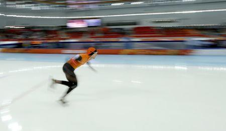 Mark Tuitert of the Netherlands starts as he competes in the men's 1,500 metres speed skating race during the 2014 Sochi Winter Olympics
