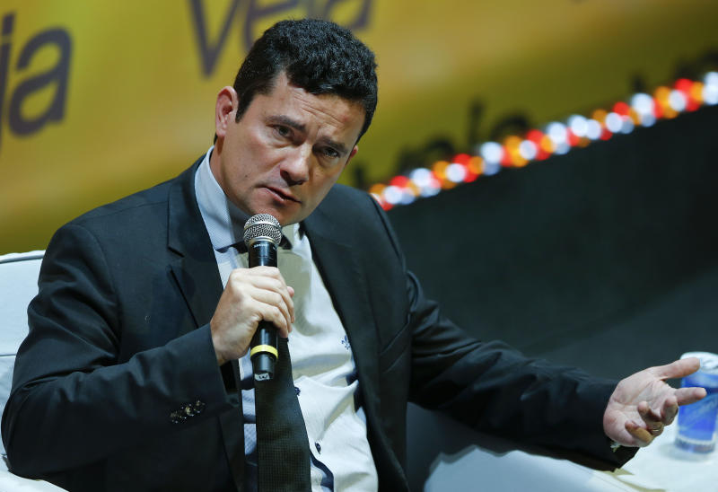 Brazilian Federal Judge Sergio Moro, who is leading the corruption probe at the state-run oil company Petrobras, speaks during a seminar on the economy, political crisis and justice in Sao Paulo, Brazil, Monday, May 23, 2016. Brazil's interim government came under fire on Monday, as a secret recording emerged of Planning Minister Romero Juca discussing an alleged agreement to push for President Dilma Rousseff's impeachment to stall the probe that has engulfed much of the South American nation's political class. Juca has said his comments had been taken out of context. (AP Photo/Andre Penner)