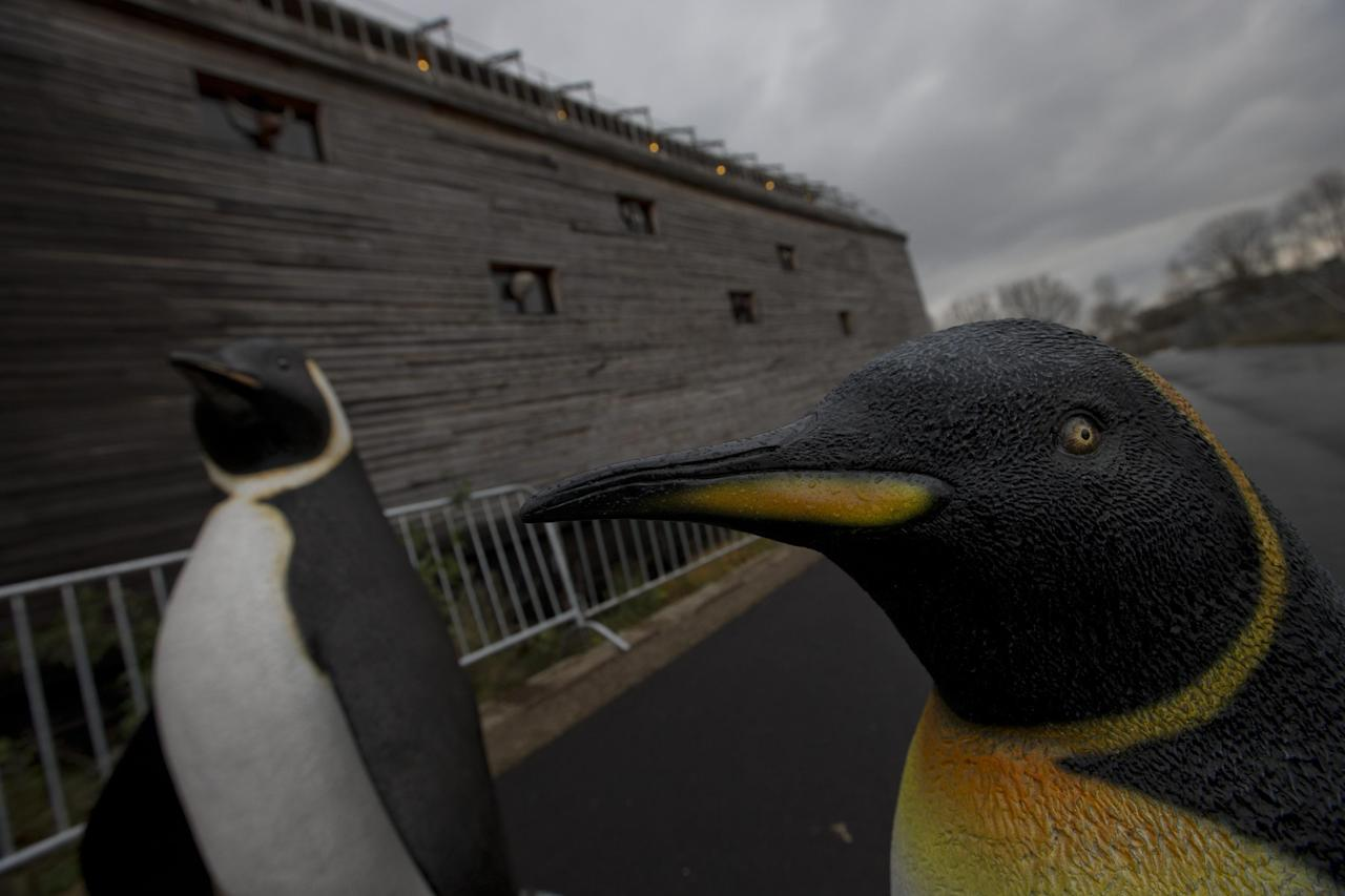 Life-seize replica's of penguins are seen outside a full scale replica of Noah's Ark which has opened its doors in Doredrecth, Netherlands, Monday Dec. 10, 2012, after receiving permission to host up to 3,000 visitors per day. Stormy weather could do nothing to dampen the good mood of its creator, Dutchman Johan Huibers: in fact, the rain was appropriate. For those who don't know or remember the Biblical story, God ordered Noah to build a boat massive enough to save animals and humanity while God destroyed the rest of the earth in an enormous flood. (AP Photo/Peter Dejong)