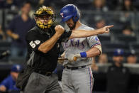 Texas Rangers' Nick Solak, right, reacts as home plate umpire Dan Iassogna, left, calls him out on strikes during the eighth inning of a baseball game against the New York Yankees, Monday, Sept. 20, 2021, in New York. (AP Photo/Frank Franklin II)