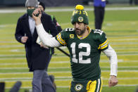 Green Bay Packers quarterback Aaron Rodgers pumps his fist after an NFL divisional playoff football game against the Los Angeles Rams Saturday, Jan. 16, 2021, in Green Bay, Wis. The Packers defeated the Rams 32-18 to advance to the NFC championship game. (AP Photo/Mike Roemer)