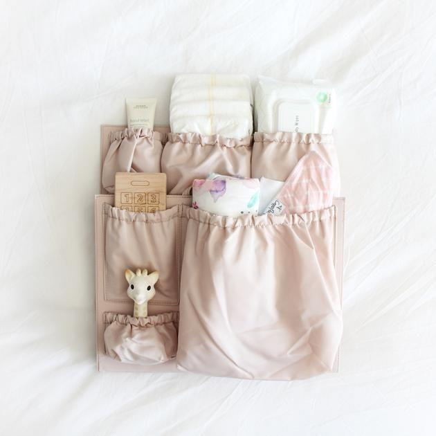 """<p><strong>ToteSavvy</strong></p><p>totesavvy.com</p><p><strong>$65.00</strong></p><p><a href=""""https://www.totesavvy.com/products/totesavvy"""" rel=""""nofollow noopener"""" target=""""_blank"""" data-ylk=""""slk:Shop Now"""" class=""""link rapid-noclick-resp"""">Shop Now</a></p><p>Here's a neat parent hack: Put the ToteSavvy into any tote bag, and — poof! — it suddenly has enough pockets to be a diaper bag. It's a perfect gift for that friend who already has a huge collection of totes, and it comes in eight colors.</p>"""