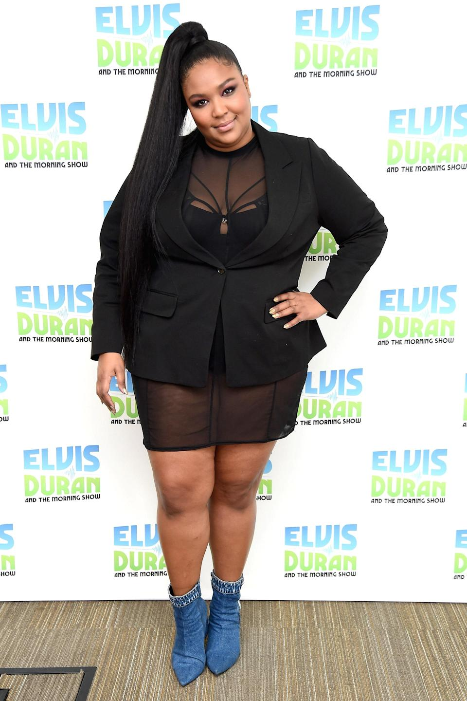 At the beginning of 2019, Lizzo kept it business casual in a black blazer, denim ankle boots, and a sleek, high ponytail.