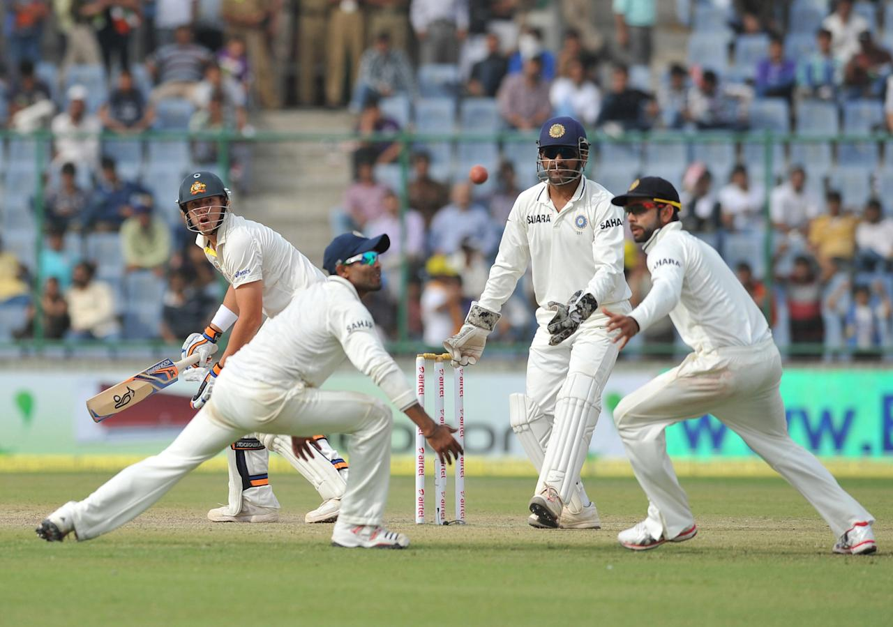 Dhoni, Virat Khohli and Ajankya Rahane of India catching as Peter Siddle of Australia miss the target during the 4th test match of Border Gavaskar Trophy, at Ferozeshah Kotla Stadium in Delhi on March 22, 2013. P D Photo by Asish Maitra
