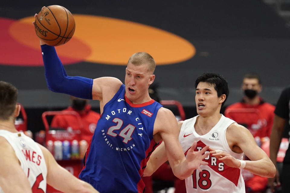 Detroit Pistons center Mason Plumlee (24) grabs a rebound from Toronto Raptors forward Yuta Watanabe, of Japan, (18) during the first half of an NBA basketball game Wednesday, March 3, 2021, in Tampa, Fla. (AP Photo/Chris O'Meara)