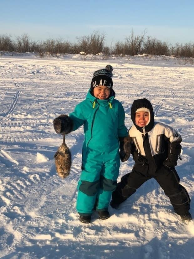 Participants trapping muskrats during the Rites of Passage program in Aklavik, N.W.T., delivered by the Inuvialuit Regional Corporation, an NWT On The Land Collaborative grant recipient. (Submitted by the Inuvialuit Regional Corporation. - image credit)
