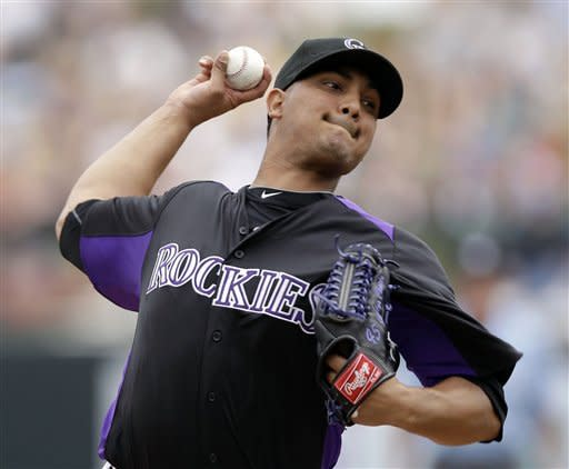 Colorado Rockies starting pitcher Jhoulys Chacin throws to the Cincinnati Reds during the first inning of a spring training baseball game on Sunday, March 25, 2012 in Scottsdale, Ariz. (AP Photo/Marcio Jose Sanchez)