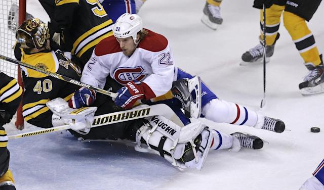 Montreal Canadiens right wing Dale Weise (22) knocks over Boston Bruins goalie Tuukka Rask (40) after a shot on goal during the third period of Game 5 in the second-round of the Stanley Cup hockey playoff series in Boston, Saturday, May 10, 2014. (AP Photo/Charles Krupa)