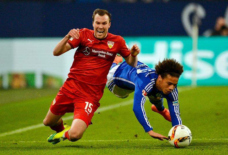 Schalke's midfielder Leroy Sane (R) and Stuttgart's defender Kevin Grosskreutz collide during a German first division Bundesliga football match on February 21, 2016 (AFP Photo/Sascha Schuermann)
