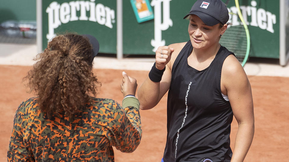 Naomi Osaka and Ash Barty, pictured here on the practice court at Roland Garros.