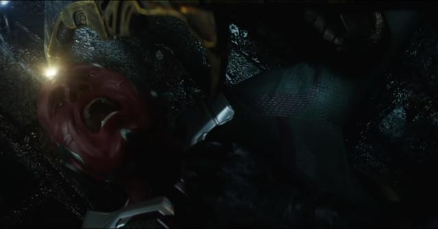 Thanos plucks the Mind Stone from Vision's forehead, perhaps spelling doom for the android Avenger and giving Thanos three of the five gems for his gauntlet. (Photo: Marvel Studios)