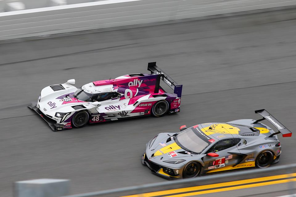 DAYTONA BEACH, FL - JANUARY 23: The #49 Ally Cadillac Racing Cadillac DPi of Jimmie Johnson, Kamui Kobayashi, Simon Pagenaud, and Mike Rockenfeller and the #4 Corvette Racing Corvette C8.R of Nick Tandy, Tommy Milner and Alexander Sims during a practice session during the Roar Before the Rolex 24 on January 23, 2021 at Daytona International Speedway in Daytona Beach, Fl. (Photo by David Rosenblum/Icon Sportswire via Getty Images)