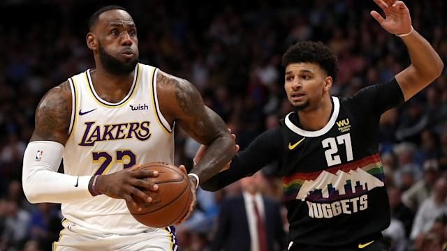 LeBron James and Anthony Davis saw the Los Angeles Lakers past the Denver Nuggets in the NBA.