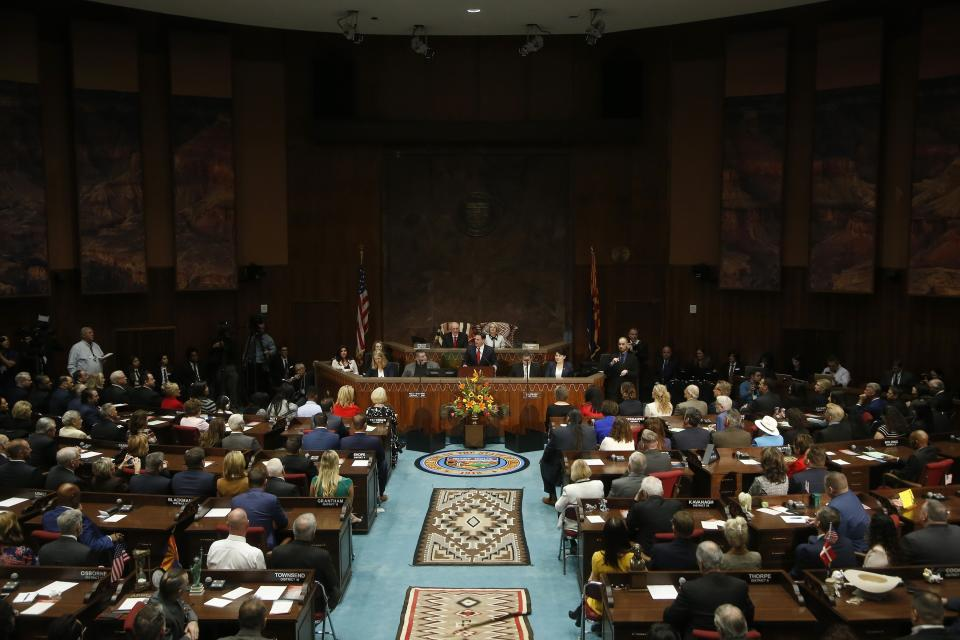 Arizona Republican Gov. Doug Ducey, back center, speaks during his State of the State address about Arizona's economy, new jobs, prison reform, and education on the opening day of the legislative session at the Capitol, Monday, Jan. 13, 2020, in Phoenix. (AP Photo/Ross D. Franklin)