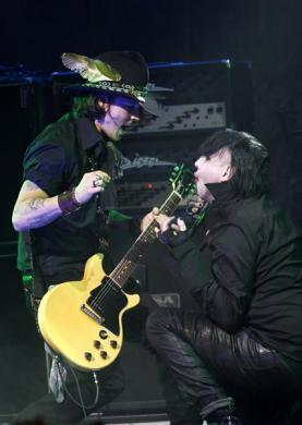 Johnny Depp performs with Marilyn Manson at the 4th annual Golden Gods awards at Nokia theatre in Los Angeles, April 11, 2012.