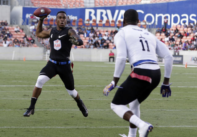 Jahvid Best looks to pass at the American Flag Football League U.S. Open of Football Ultimate Championship in Houston. (AP)