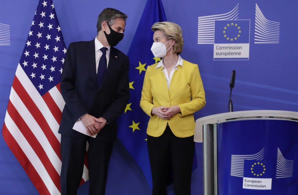 U.S. Secretary of State Antony Blinken, left, is greeted by European Commission President Ursula von der Leyen prior to addressing a media conference at EU headquarters in Brussels on Wednesday, March 24, 2021. (Olivier Hoslet, Pool via AP)