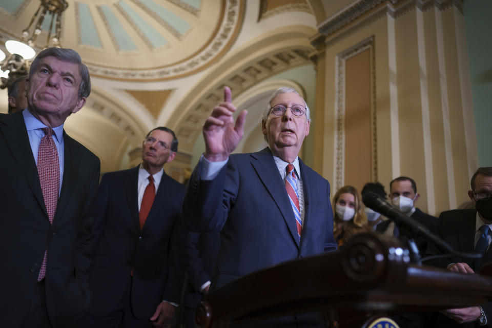 Senate Minority Leader Mitch McConnell, R-Ky., joined from left by Sen. Roy Blunt, R-Mo., and Sen. John Barrasso, R-Wyo., speaks to reporters as work continues on the Democrats' Build Back Better Act, massive legislation that is a cornerstone of President Joe Biden's domestic agenda, at the Capitol in Washington, Tuesday, Sept. 14, 2021. (AP Photo/J. Scott Applewhite)