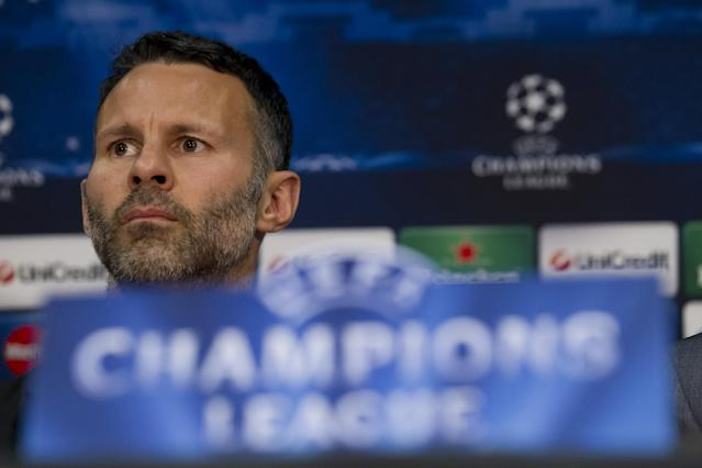 FILE - This is a Monday, March 31, 2014 file photo of Manchester United player Ryan Giggs as he listens to a question during a press conference at Old Trafford Stadium, Manchester, England. Giggs is one of the potential full-time replacements for David Moyes as Manchester United manager after his firing on Tuesday, April 22, 2014. (AP Photo/Jon Super, File)