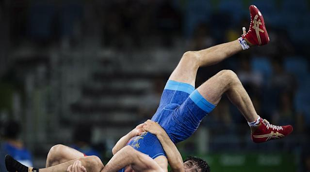 <p>Kazakhstan's Galymzhan Usserbayev vs. Moldova's Evgheni Nedealco (in blue) during the Men's 74kg Freestyle Round of 32 match at the Carioca Arena 2 in Rio de Janeiro, Brazil. </p>