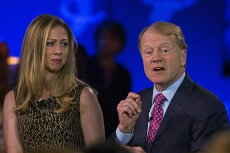 John Chambers, chairman and CEO of Cisco speaks in front of Chelsea Clinton at the Clinton Global Initiative in New York