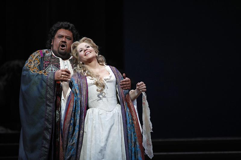 """In this Friday, Oct. 5 2012 photo, Johan Botha performs the title roll alongside Renee Fleming performing as Desdemona during the final dress rehearsal of Guiseppe Verdi's """"Otello"""" at the Metropolitan Opera in New York. (AP Photo/Mary Altaffer)"""
