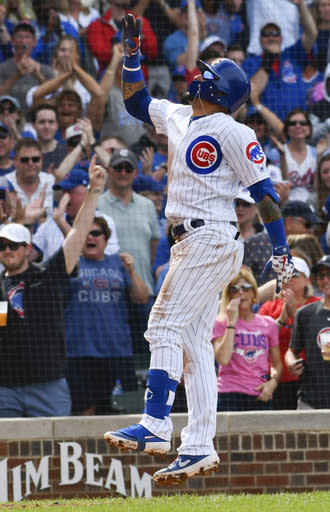 Chicago Cubs' Javier Baez (9) reacts after he hit a three run home run during the eighth inning of a baseball game against the New York Mets Sunday, June 23, 2019, in Chicago. (AP Photo/Matt Marton)