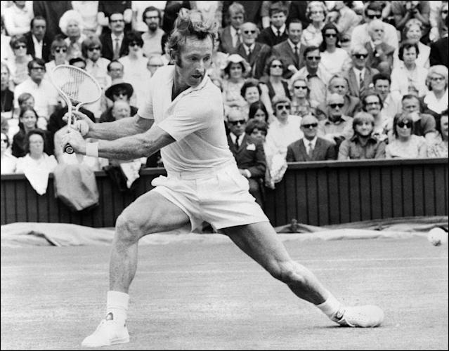 In this file photo taken on June 27, 1971, Rod Laver stretches to play a backhand return against Tom Okker at Wimbledon (AFP Photo/STR)