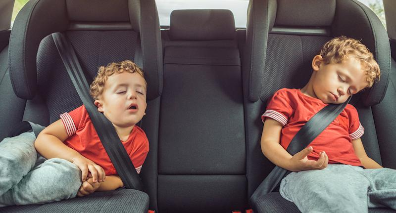 How much sleep do you need? children sleeping in the backseat of a car