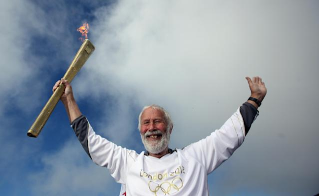 Sir Chris Bonington holds the Olympic torch on the summit of Mount Snowdon on May 29, 2012 in Llanberis, United Kingdom. Legendary mountaineer Sir Chris Bonington, aged 77, was given the honour of carrying the torch to the summit of Wales's highest mountain, the place his climbing career began 61 years ago. The Olympic Flame is now on day 11 of a 70-day relay involving 8,000 torchbearers covering 8,000 miles. (Photo by Christopher Furlong/Getty Images)