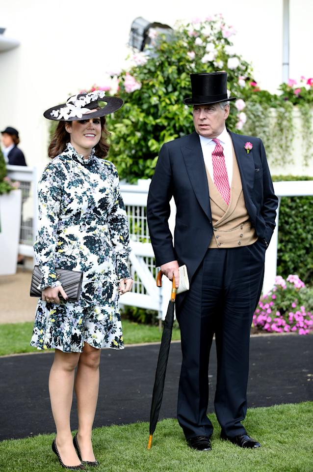 <p>Princess Eugenie, pictured here with her father the Duke of York, wore a floral, high-neck dress for her Ladies Day look. <em>[Photo: PA]</em> </p>
