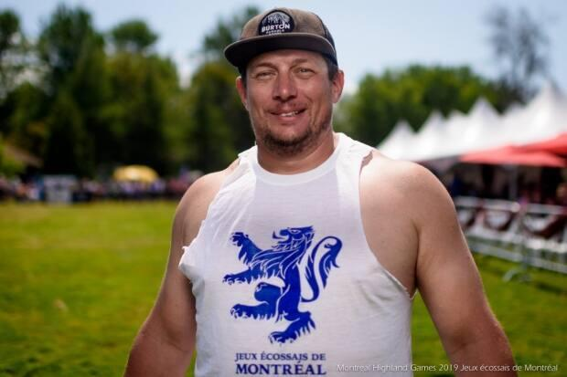 Jason Baines, raised in Greenfield Park, is the athletic director of the Montreal Highland Games. On Sunday, he will attempt to beat the Guinness World Record for the most tosses in an hour. (Montreal Highland Games - image credit)