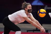 Outside hitter Jordan Larson, a two-time Olympic medalist with Team USA, reaches out to make a pass during volleyball practice in Dallas, Wednesday, Feb. 24, 2021. (AP Photo/Tony Gutierrez)